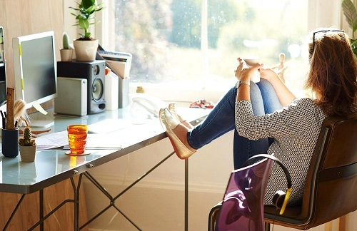 Woman Drinking Coffee In Home Office