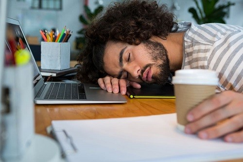 Man Taking Nap On Work At Home