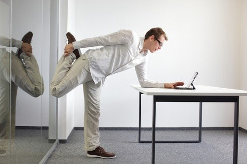 Leg exercise during office work.